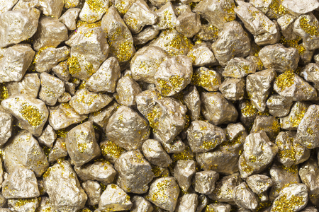 tough luck: background and texture of golden stones Stock Photo