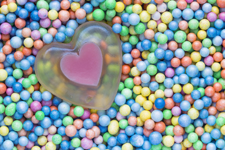 heart soap on colored balls photo