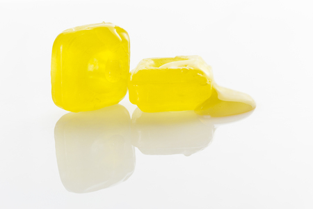 oxygenated: honey candies cough on white background