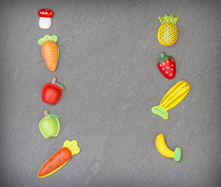recreation of pieces of fruit and vegetables in slate background