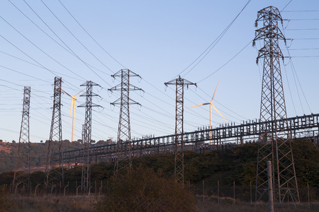 electrical pylons with windmills