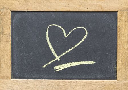 blackboard drawing stone with a heart