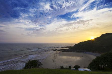 Sunrise on the coast of asturias, spain