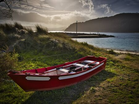Red boat docked