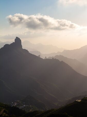 Roque Bentayga, layered landscape at sunset on the island of Gran Canaria, Canary Islands, Spain. Vertical