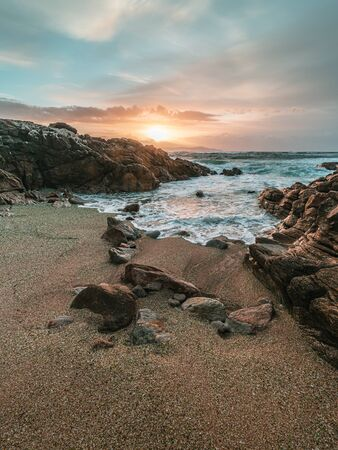 Sunset on the sea at Los Cristales beach in Laxe, Galicia, Spain.