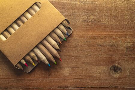 wooden colored pencils on vintage wooden desk.Close up. Top view with copy space. RGB concept.