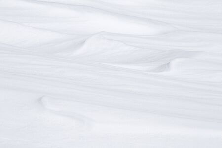 White background of wind-molded snow. Winter backdrop.