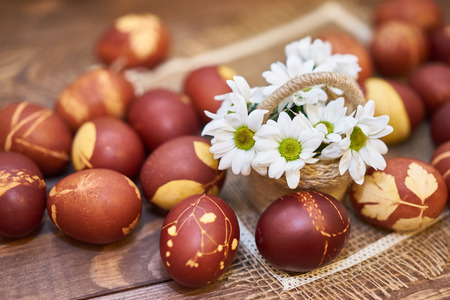 sentimental: Easter eggs composition - rustic style flower right side Stock Photo