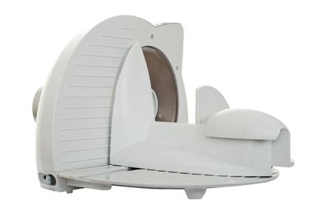 slicer: Kitchen machine food slicer isolated on white Stock Photo