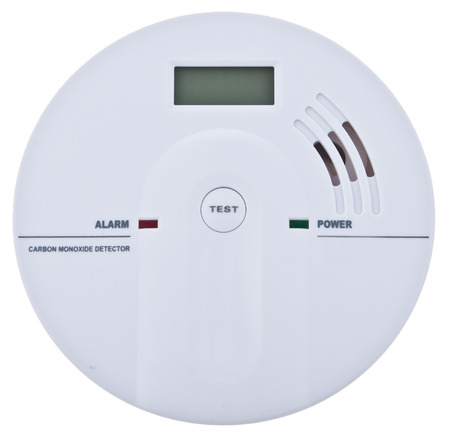 Carbon monoxide alarm isolated over white photo