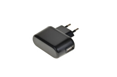 AC power adapter plug transformer isolated on white photo