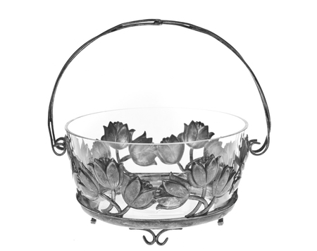 meta: An old bowl with flowers - isolated over white background.