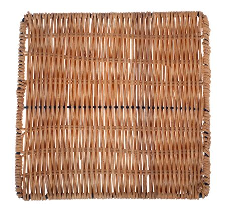 A Woven Wicker Placemat hand crafted Stock Photo