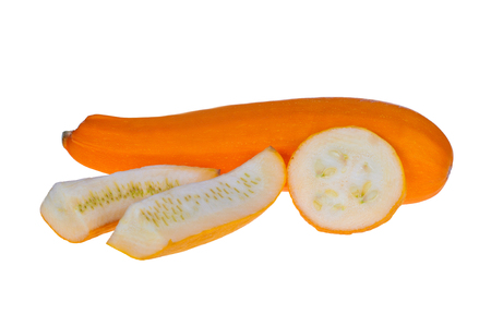 A yellow courgette variety on a white background with shadow,