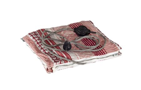 Electric heating pad on white background.  Stock Photo