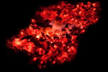 Glowing embers with flying sparks Stock Photo