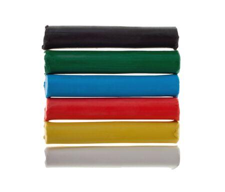 Color childrens plasticine on white background