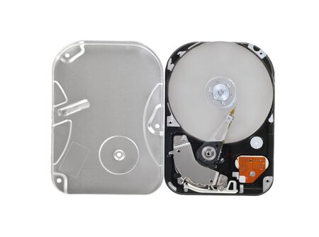 Opened computer hard disc  on a white background.