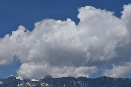 Cumulus cloud is appearing in the blue sky over Liechtenstein 27.4.2020