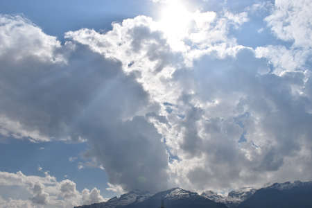 Cumulus cloud is appearing in the blue sky over Liechtenstein 26.4.2020