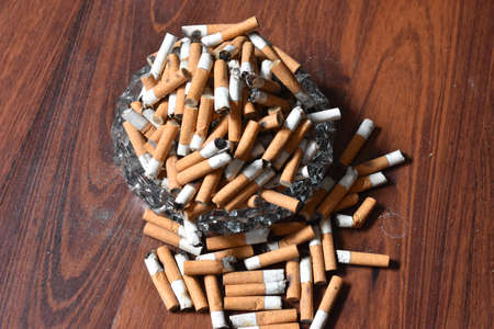 Ashtray overloaded with used cigarettes 12.5.2020