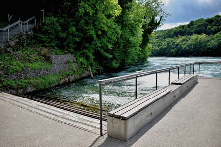 Rhine river flows its way ahead after passing the falls near Schaffhausen in Switzerland 20.5.2020