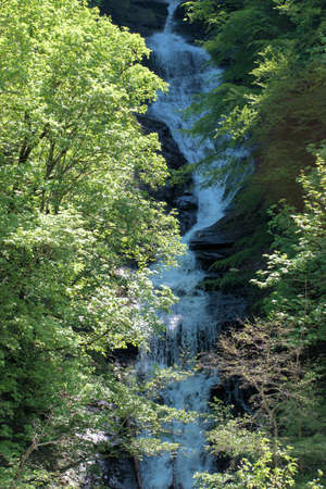 Beautiful cascade in the countryside of the Weisstannental in Switzerland 28.5.2020