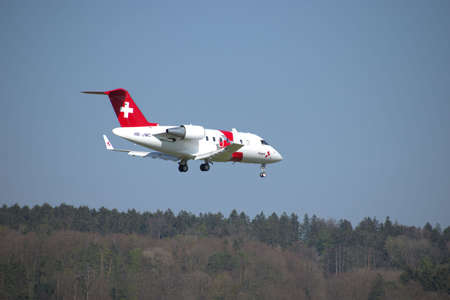 Rega ambulance jet Bombardier CL 600 2B16 on the final approach to the international airport in Zurich in Switzerland 24.4.2021