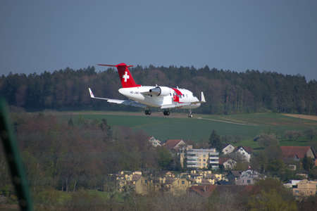 Rega ambulance jet Bombardier CL 600 2B16 on the final approach to the international airport in Zurich in Switzerland 24.4.2021 Publikacyjne