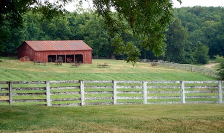 lawson: Lawson, Missouri - July 10, 2010: Watkins Woolen Mill State Historic Site red barn and fence