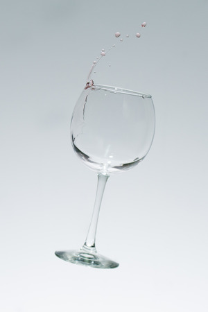 chardonnay: High speed photography freezes wine drops as they fly from a chardonnay glass.