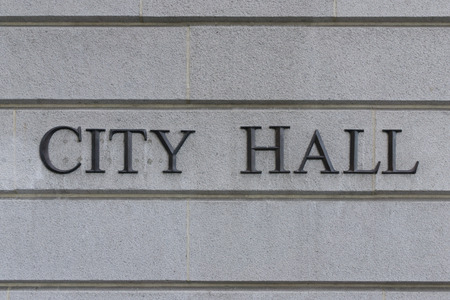 at sign: City Hall Sign Stock Photo