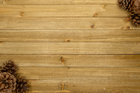 Rustic wood plank background with pine cones