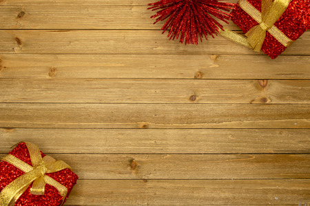 Holiday wood background with small gift boxes Imagens