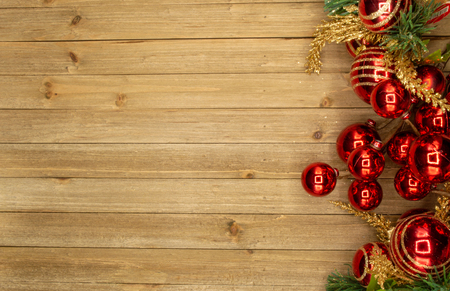 Holiday wood background with red ornaments Imagens