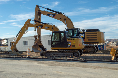 Castle Rock, Colorado  United States - October 28, 2018: Two Yellow Excavators at Construction Site Editorial
