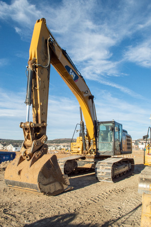 Castle Rock, Colorado  United States - October 28, 2018: Yellow Excavator at Construction Site