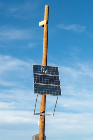 Solar panel on a pole used to power a security camera