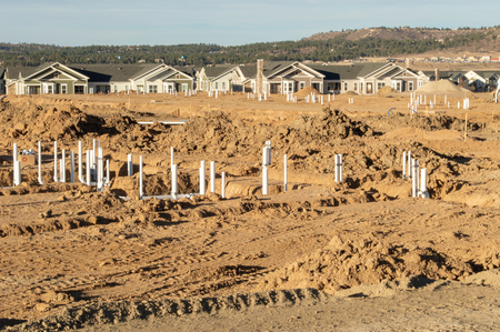 Foundation work at new housing development showing all of the sewer and water pipes being installed Imagens