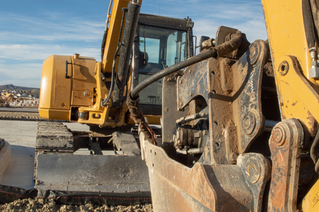 Angle from front of yellow excavator