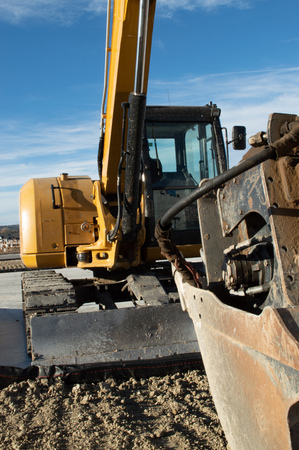 Interesting angle of a large excavator at a new housing development in Castle Rock, Colorado
