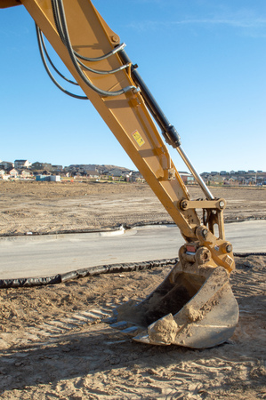 Excavator arm and bucket at a new housing development in Castle Rock, Colorado