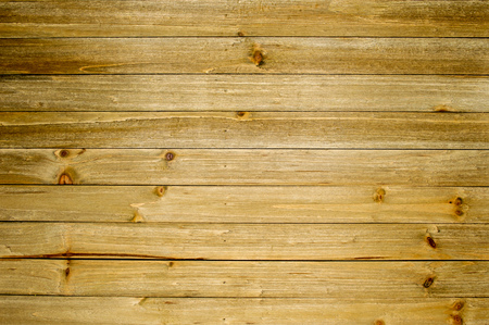 Wood plank background that shows some of the weather of being outside. Imagens