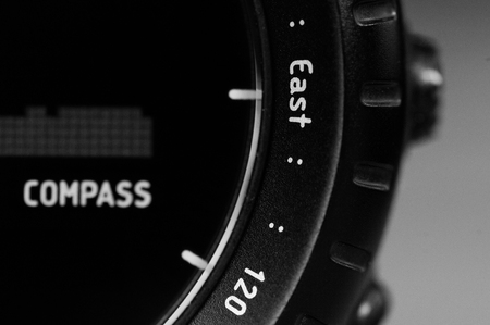 Detail close-up of black wristwatch with compass