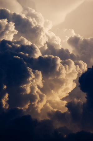 Dark and dramatic cumulus clouds forming into thunderstorm 写真素材