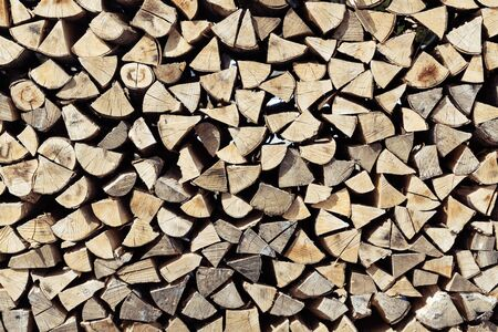 Frontal view closeup of neatly stacked pile of cut and split spruce tree firewood. Forestry, renewable fuel, sustainability and environment concepts. 版權商用圖片