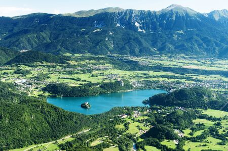 Aerial view of lake Bled and surrounding mountains in Slovenia. Sightseeing, travel and tourism concepts