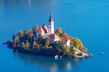 Beautiful view of the island with church of the Assumption of Mary on lake Bled in Slovenia. Landmarks, travel, tourism and beauty of nature concepts