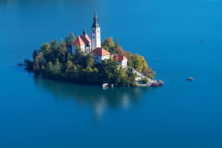 Aerial view of the island with church of the Assumption of Mary on lake Bled in Slovenia. Landmarks, travel, tourism and beauty of nature concepts